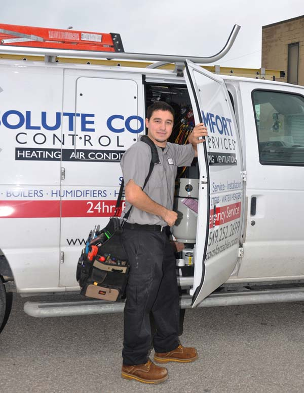 Absolute Comfort technician standing by van