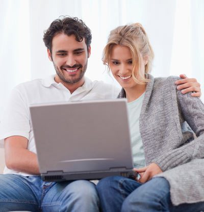 An image of a couple using a laptop