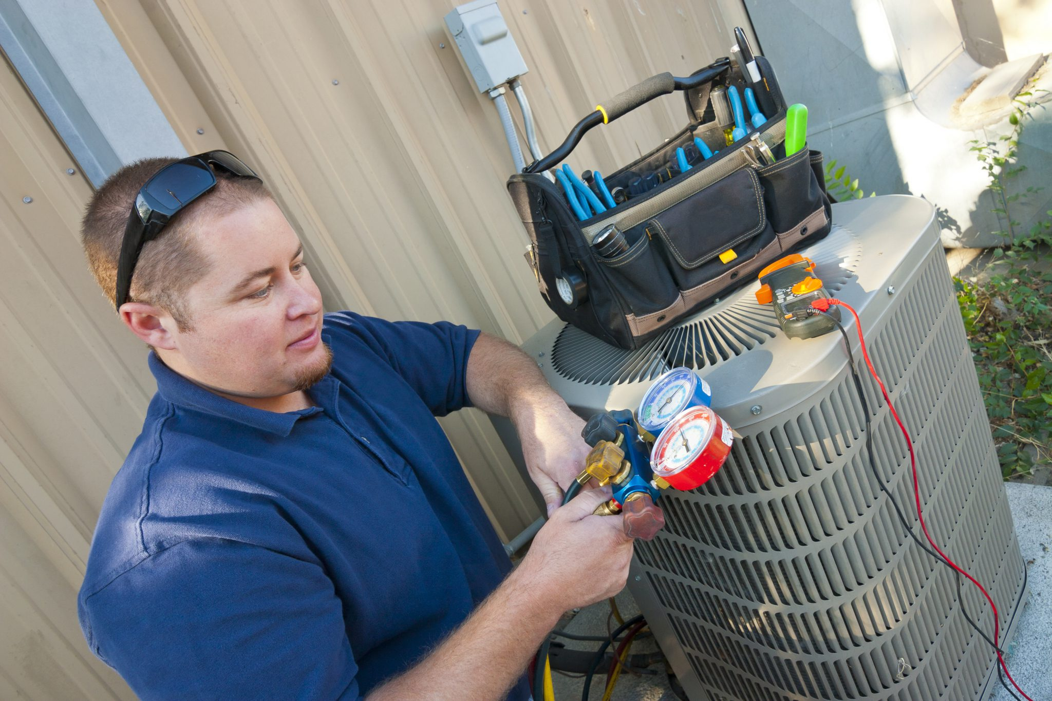 An Absolute Comfort employee upgrading air conditioning system