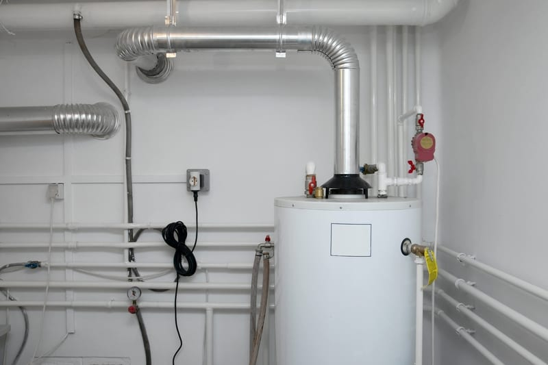 Home basement piping and furnace