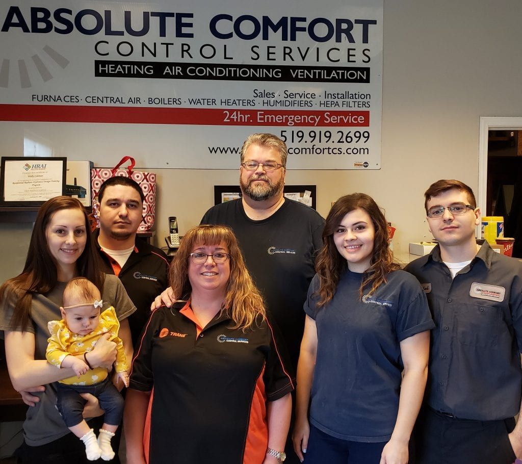 Absolute Comfort family portrait & employees