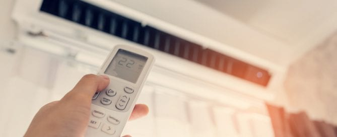 Person controlling their Air conditioning unit