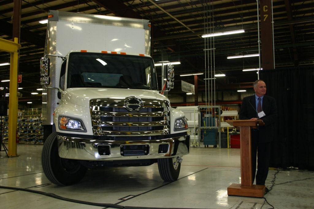 presenter standing next to hino truck