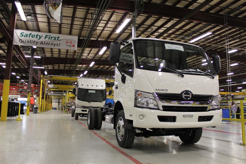 two trucks on assembly line