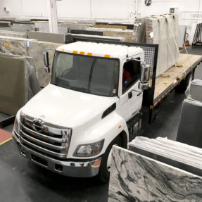 truck carrying stone slabs on trailer