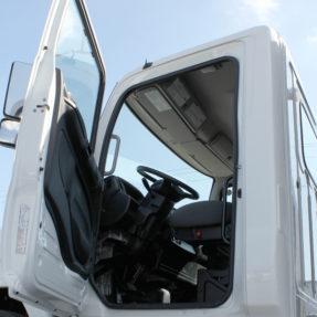 side view of truck cab with door open